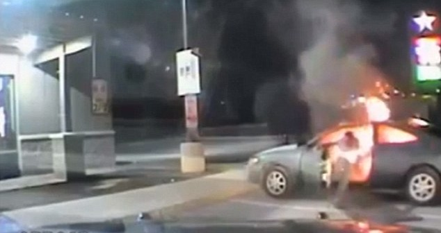Horrifying moment man tries to kill himself by setting car on fire in parking lot of gas station